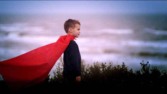 Aesthetic Blasphemy | Image of a boy wearing a red cape