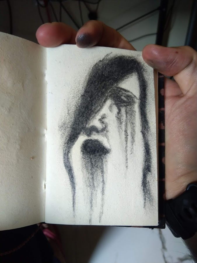 Aesthetic Blasphemy | Pencil sketch of a female face with bleeding black color as if fading