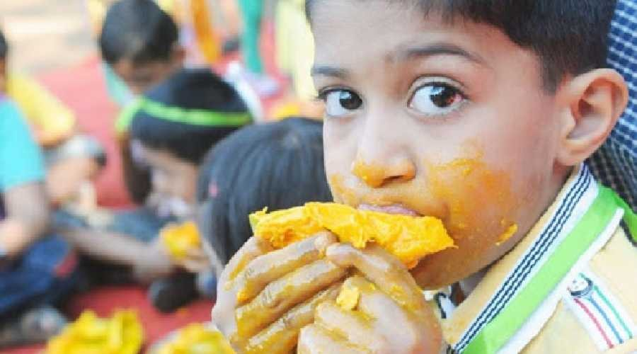 Aesthetic Blasphemy | A child eating a cut mango